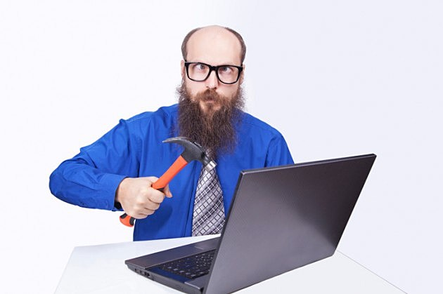 Angry Bearded Guy Hammering Laptop