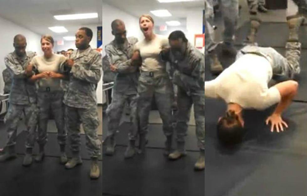 military girl takes shot from taser grabs military guy s junk