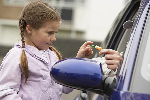 Girl taking candy from stranger